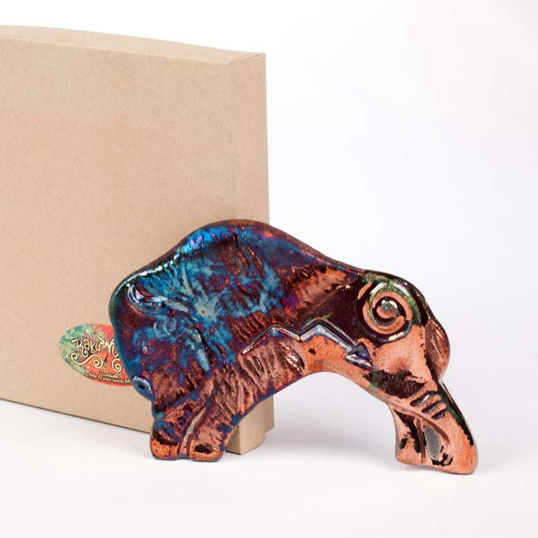 buffalo figurine in front of a box