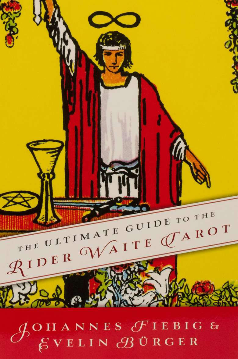 book titled the ultimate guide to the rider waite tarot