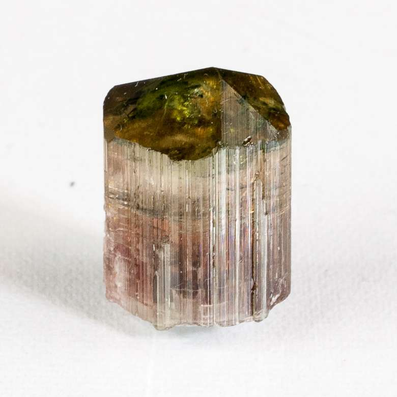 small crystal with green, orange, and red coloring