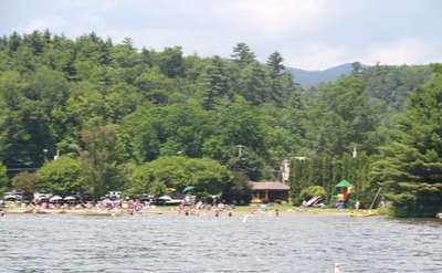 View from the water of people swimming and relaxing at Hague Town Beach