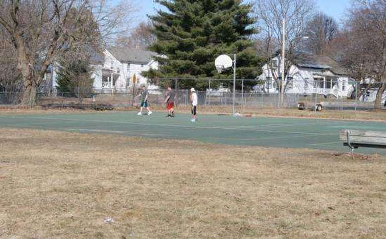 people playing basketball on court