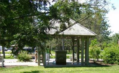 covered pavilion protecting geyser spring