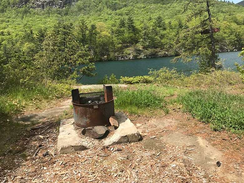 Metal fireplace in the middle of Bass Island on Lake George