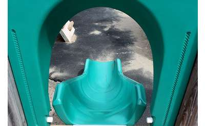 a turquoise colored slide for kids