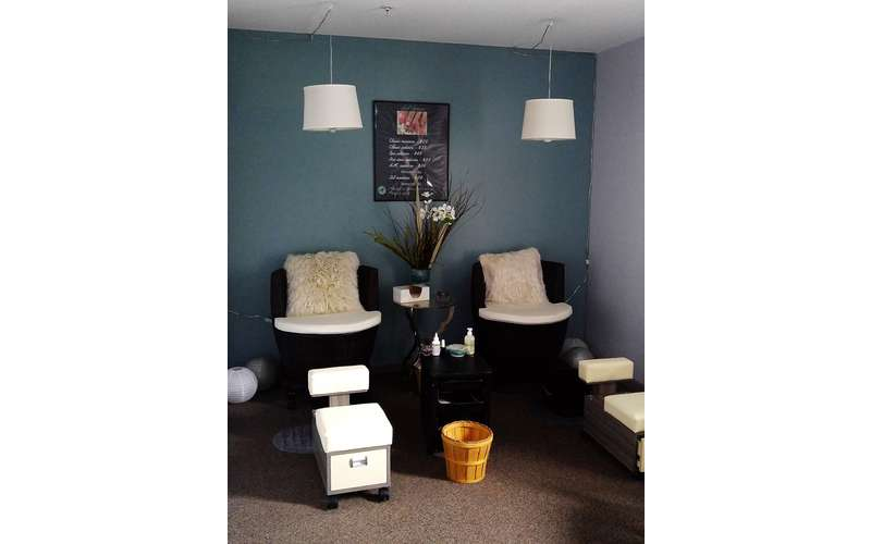 Our nail room complete with comfy chairs and pillows. We use a pipeless foot bath system with disposable liners for a clean and sanitary pedicure.