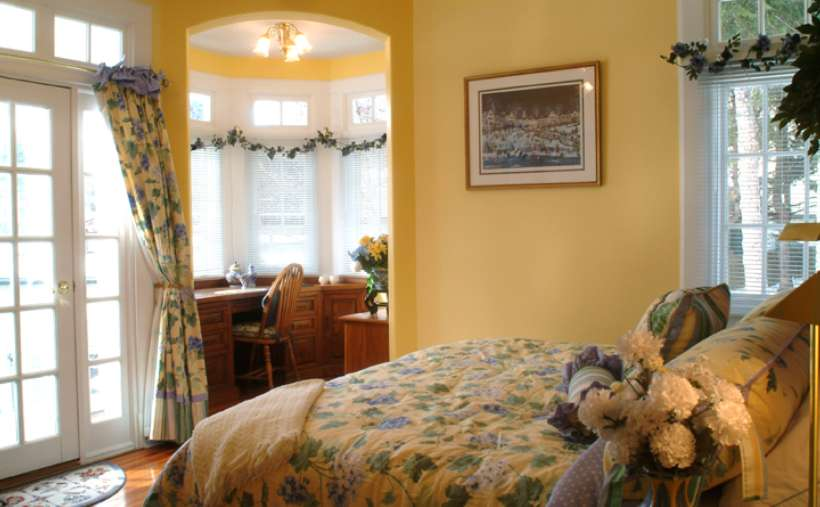 a bedroom decorated with floral print