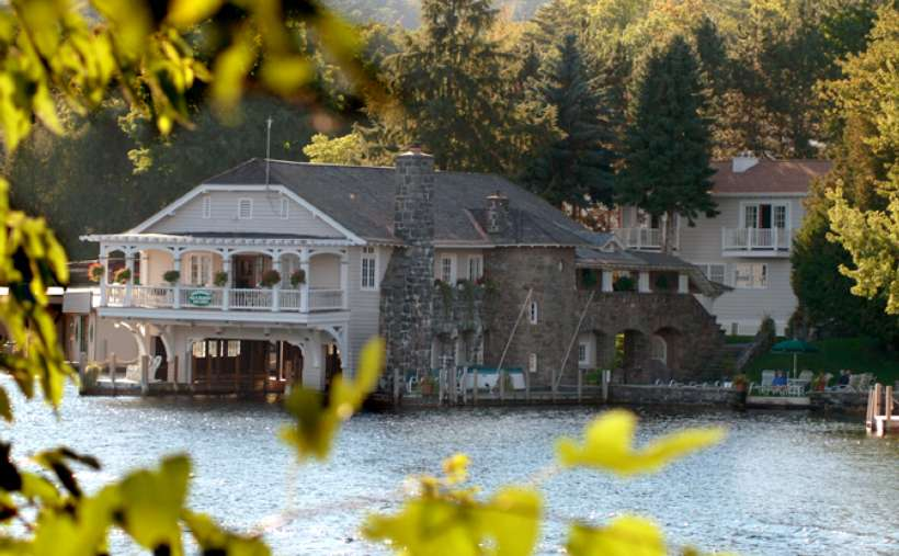 view of bed and breakfast across the water through trees