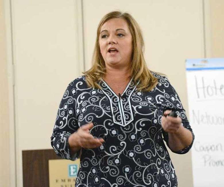 a woman giving a talk