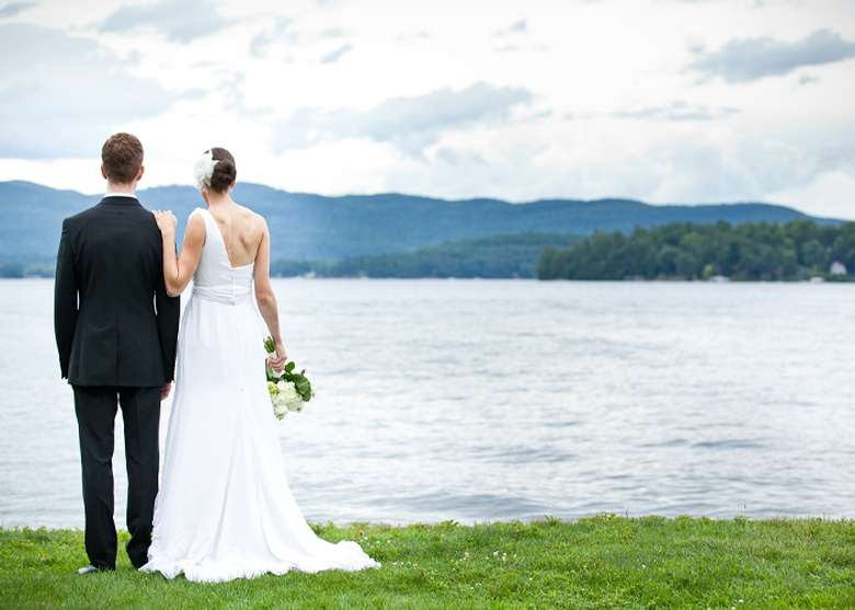 bride and groom overlooking the water