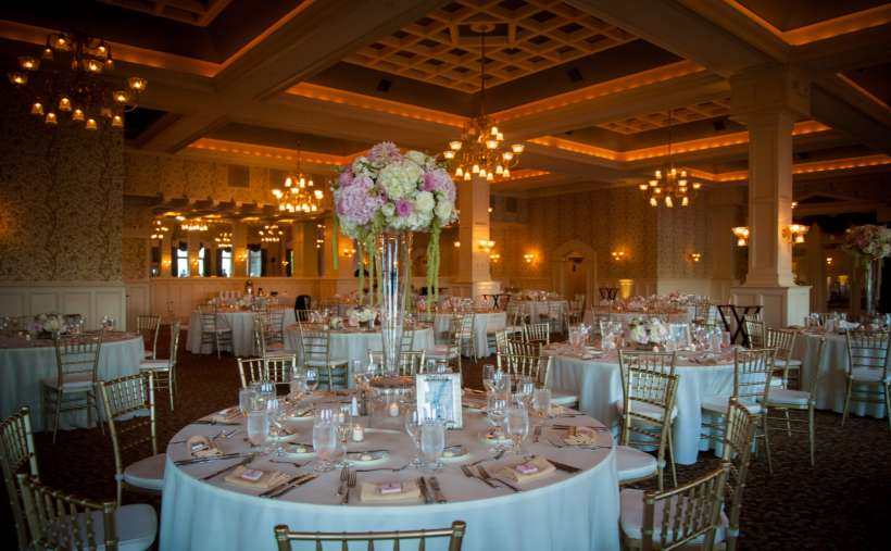 a ballroom set up for a wedding