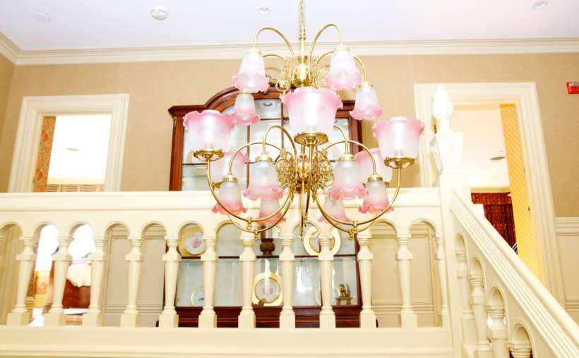 a chandelier with pink lights