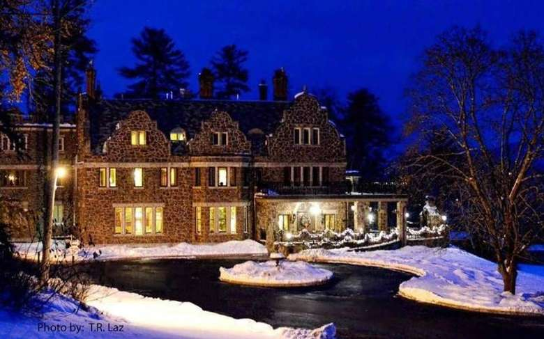 nighttime exterior photo of Inn at Erlowest in the winter