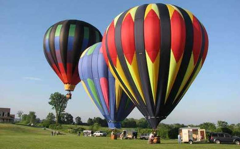 three hot air balloons ready for takeoff