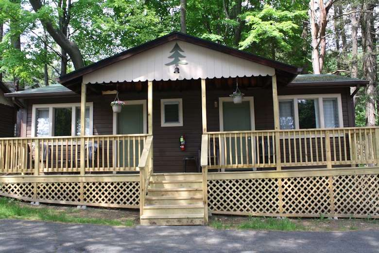 cottage with what looks like a new deck