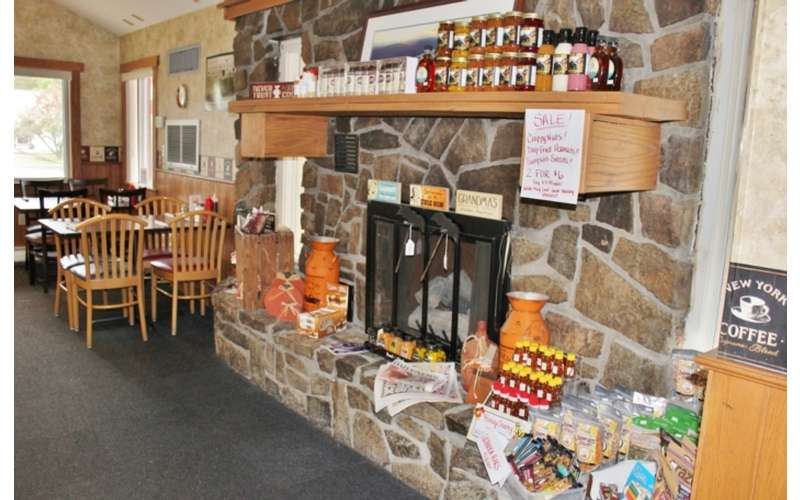 gifts and products on display near a fireplace
