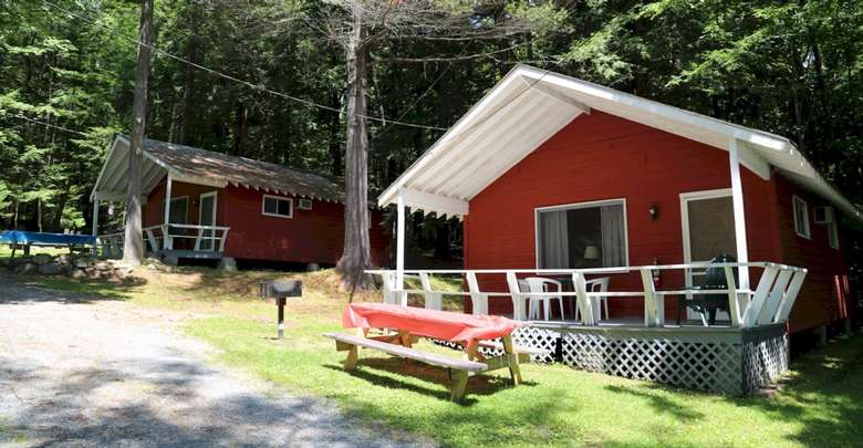 two cabins, picnic table and grill out front