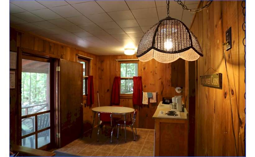 close up of lamp in a cabin, small kitchen with table and chairs