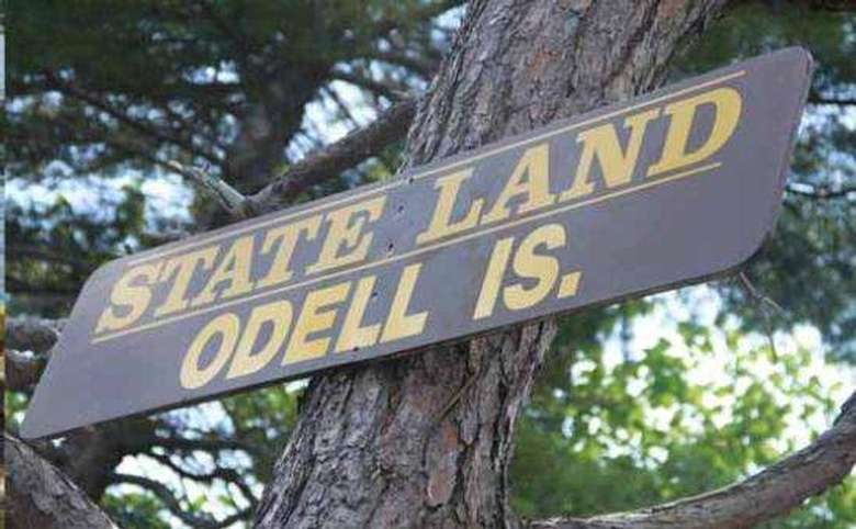 """State Land Odell Is."" sign"