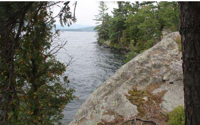 a rocky cliff overlooking a lake