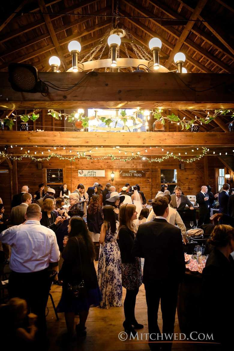 wedding guests attending a reception in a barn
