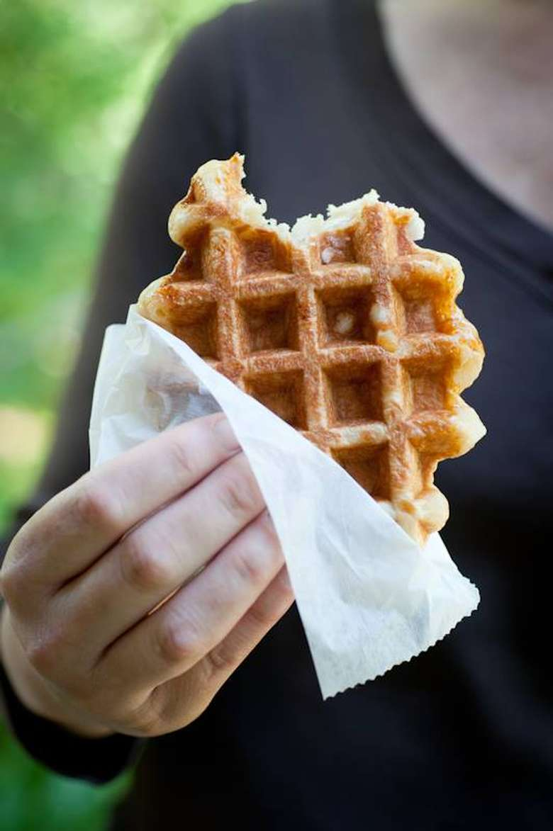 person holding waffle in paper