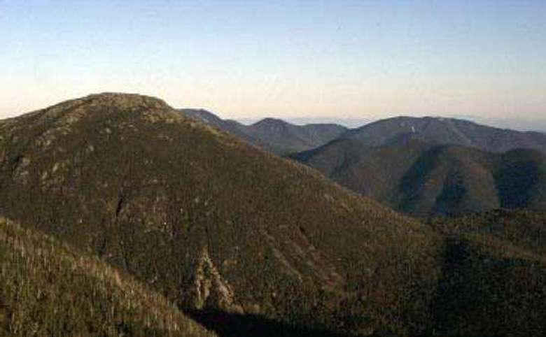 several mountain peaks at sunrise