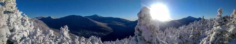 sun shining between mountains
