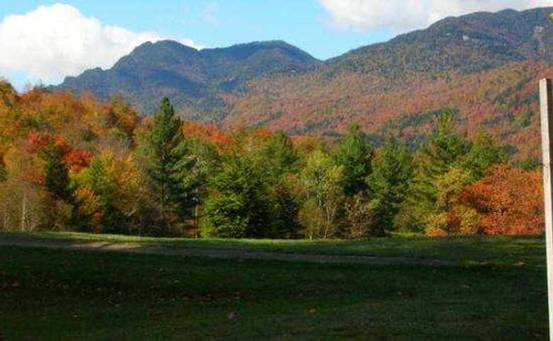 several mountains covered in fall foliage