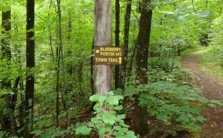 sign marking the routes to blueberry and porter mountains and the town trail
