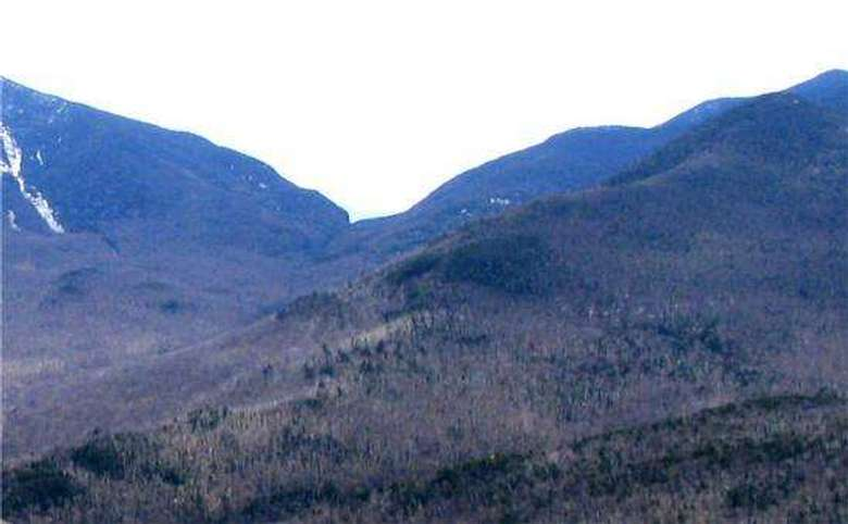 view of mountains from the summit of another mountain