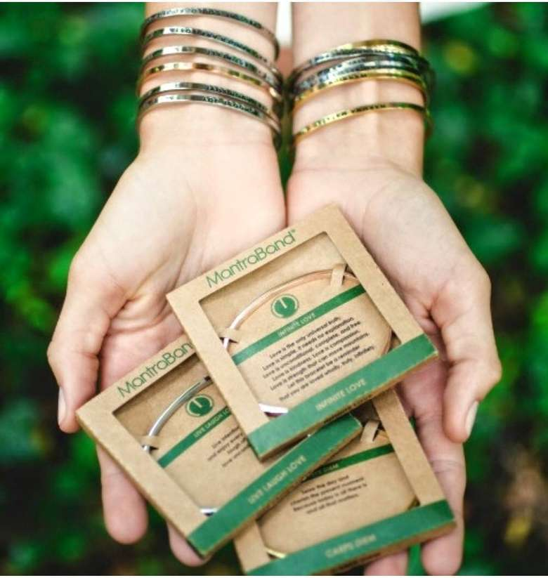 woman holding mantrabands