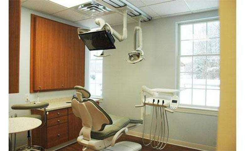 dental chair with a flat screen tv mounted above it