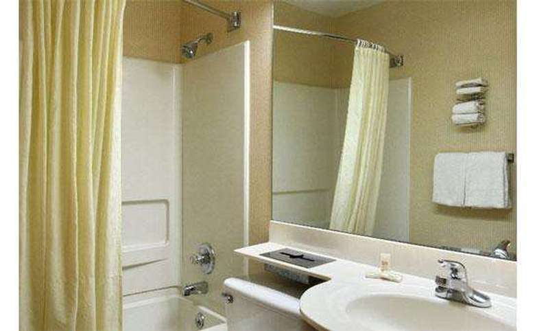 Bathroom with shower, bath and sink in sight