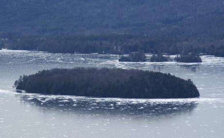 view of islands in lake george from shelving rock in winter