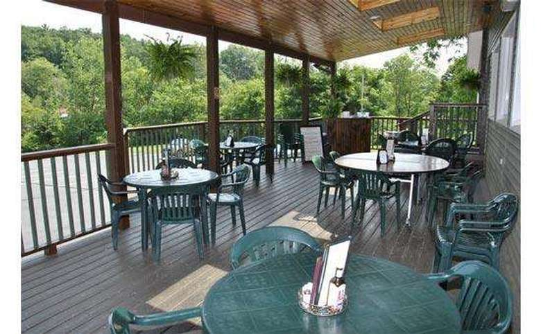 outdoor patio with tables and menus