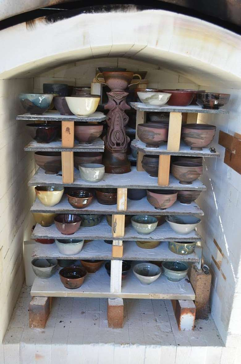 pottery loaded into a kiln