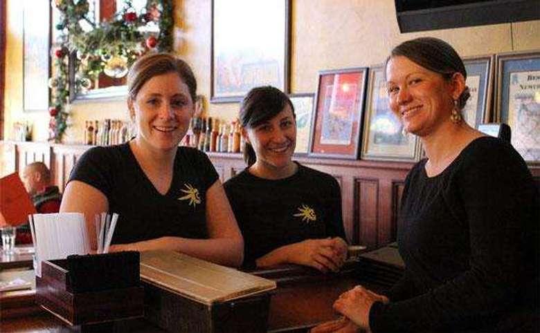 three cantina servers in black shirts