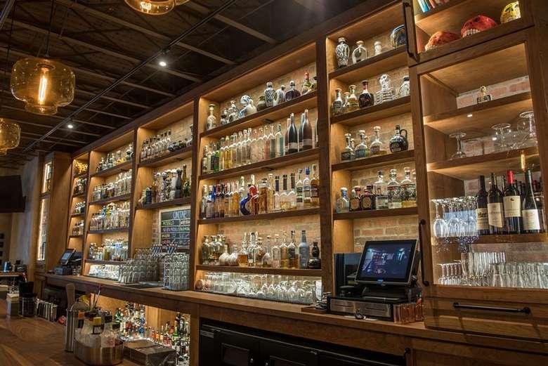 bottles on wall behind a bar