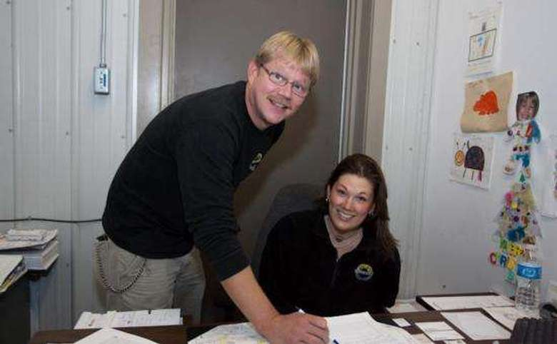 two boxley's employees reviewing paperwork