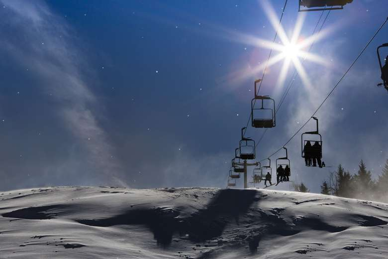 ski lift with night sky