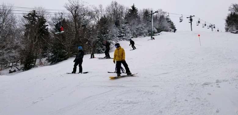 people skiing down McCauley Mountain