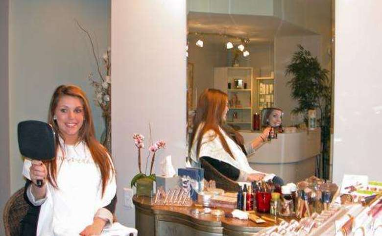 woman admiring her makeup in the mirror