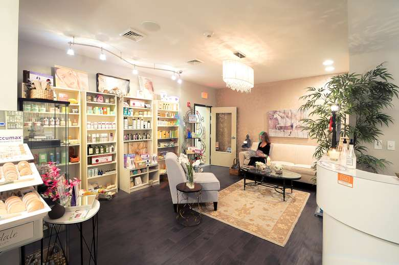 esthetiques lobby with reception desk and shelves full of products