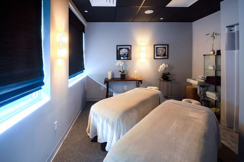 massage treatment room with two tables