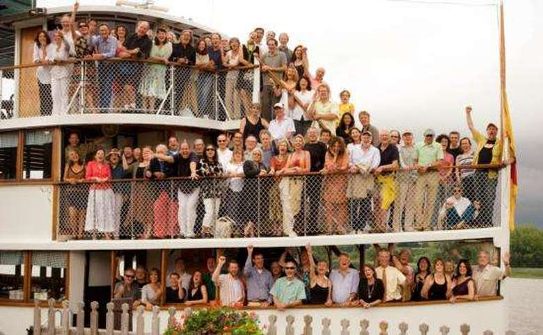 dozens of people on three levels of a cruise boat