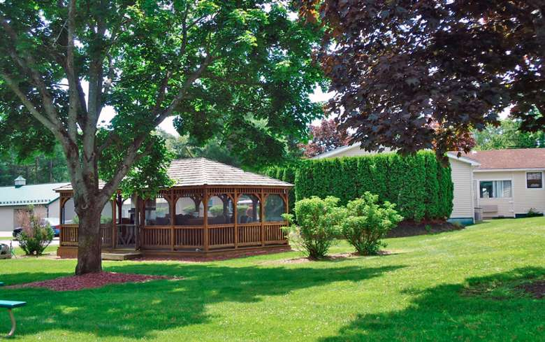 screened-in gazebo in a yard