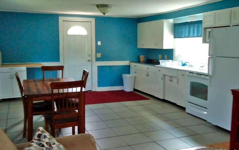 kitchen with blue walls, white cabinets, and tiled floors