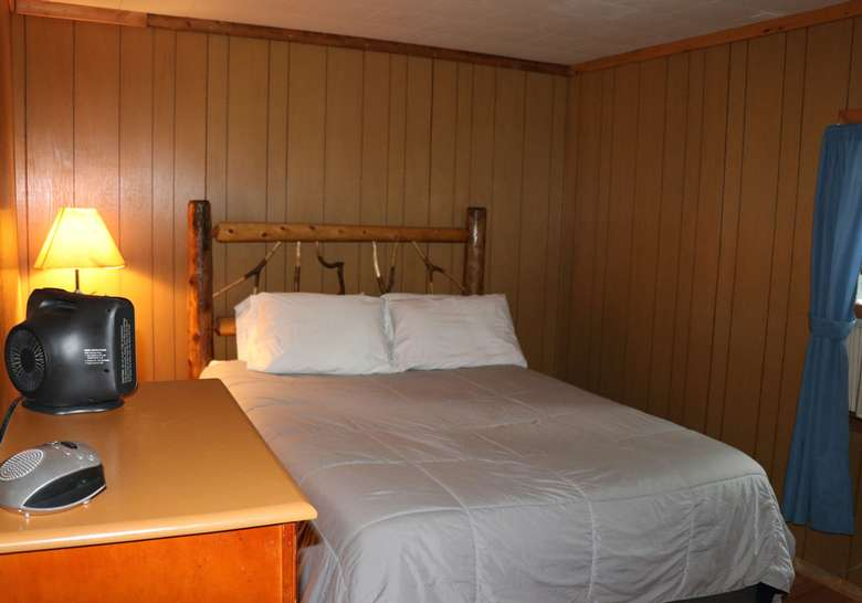 bed with nightstand and lamp