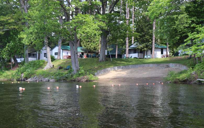 view of beach area from the water, cottages behind