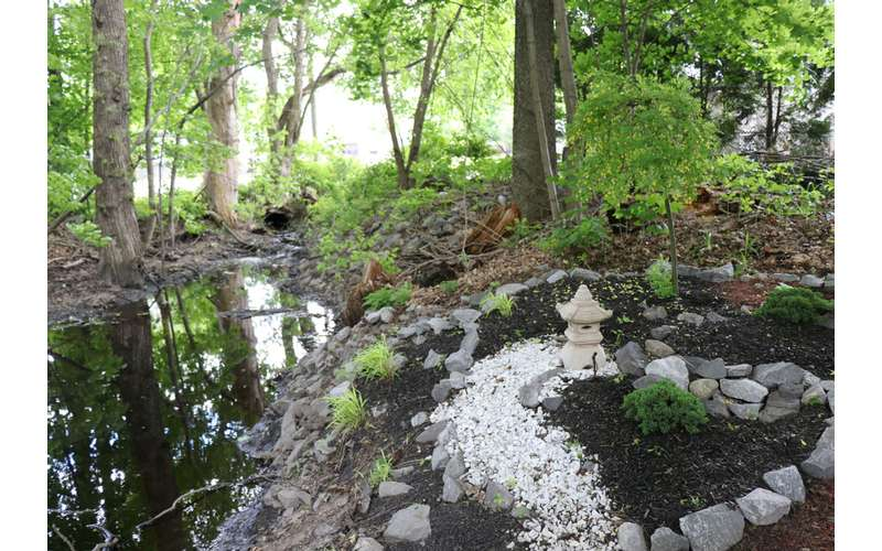 a rock garden by a stream